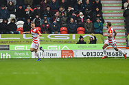 Herbie Kane of Doncaster Rovers (15) scores a goal and celebrates to make the score 2-0 with James Coppinger of Doncaster Rovers (26) during the EFL Sky Bet League 1 match between Doncaster Rovers and Scunthorpe United at the Keepmoat Stadium, Doncaster, England on 15 December 2018.