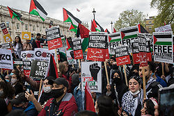 Thousands of people holding Free Palestine placards and Palestinian flags attend an emergency rally in solidarity with the Palestinian people organised outside Downing Street by Palestine Solidarity Campaign, Friends of Al Aqsa, Stop The War Coalition and Palestinian Forum in Britain on 11th May 2021 in London, United Kingdom. The rally took place in protest against Israeli air raids on Gaza, the deployment of Israeli forces against worshippers at the Al-Aqsa mosque during Ramadan and attempts to forcibly displace Palestinian families from the Sheikh Jarrah neighbourhood of East Jerusalem.