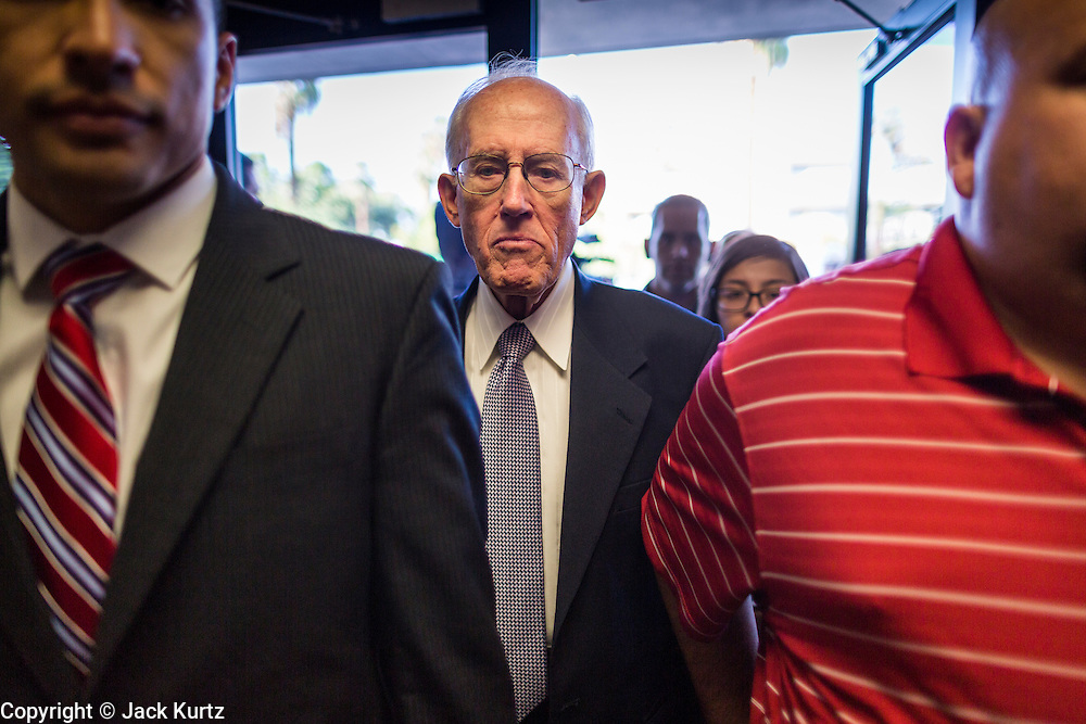 17 OCTOBER 2013 - PHOENIX, AZ:  DON JOHNSON, a retired accountant from Mesa, AZ, walks into the offices of the Arizona Attorney General to be arrested for civil disobedience Thursday. About 100 people came to the office of Arizona Attorney General Tom Horne to protest the decision by Horne to sue community colleges in Maricopa County that charge DREAM Act students who are residents of Arizona out of state tuition rather than in state resident tuition. Nearly 10 people were arrested in a planned civil disobedience during the protest.     PHOTO BY JACK KURTZ