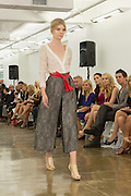 Gray and black wide-legged trousers and white top. By Carmen Marc Valvo at the Spring 2013 Fashion Week show in New York.