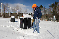 Jeff McCormack routinely checks on his bee hives throughout the winter months at McCormack's Farm in Gilmanton.  (Karen Bobotas/for the Laconia Daily Sun)