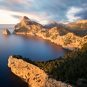 Cap de Formentor at golden hour. Cap de Formentor forms the eastern end of Majorca's Formentor peninsula. The Majorcans also call the cape the Meeting point of the winds