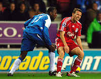 Photo: Paul Greenwood.<br />Wigan Athletic v Liverpool. The Barclays Premiership. 02/12/2006. Liverpool's Craig Bellamy, right, reacts after Wigan's Fitz Hall steals the ball from him.