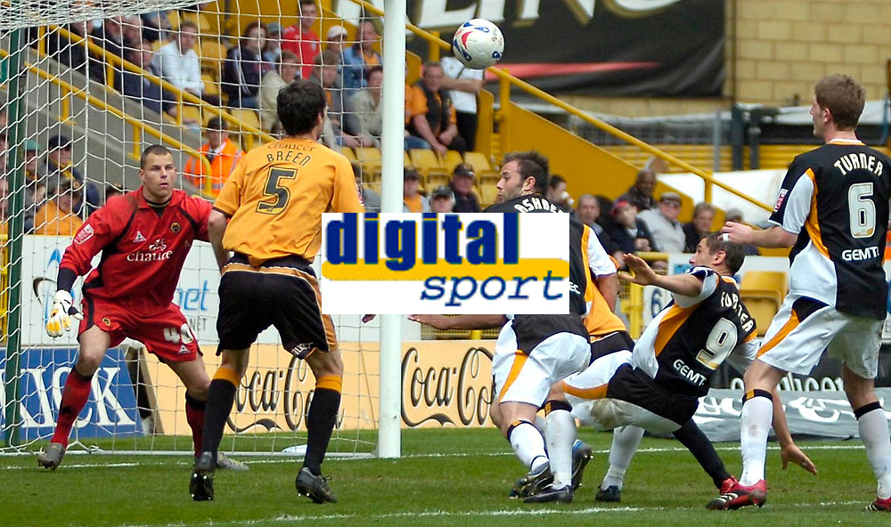 Photo: Ed Godden/Sportsbeat Images.<br />Wolverhampton Wanderers v Hull City. Coca Cola Championship. 09/04/2007. Hull's Nicky Forster and Ian Ashbee scramble for the ball in the area.