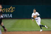 Oakland Athletics shortstop Adam Rosales (16) chases down a Miami Marlins pop fly at Oakland Coliseum in Oakland, Calif., on May 23, 2017. (Stan Olszewski/Special to S.F. Examiner)