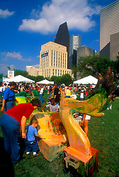 Stock photo of children participating in various crafts in the park in downtown Houston