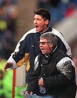 Egil Olsen (manager) & Ray Harford (assistant) -  Wimbledon, urge their players on after the 1st goal. Wimbledon v Newcastle United, 22/01/2000. Credit: Colorsport / Andrew Cowie.