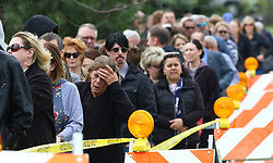 May 3, 2019 - Crystal Lake, Illinois, U.S. - Mourners stand in line to attend the visitation for 5-year-old Andrew ''AJ'' Freund at the Davenport Family Funeral Home and Crematory on Friday. AJ's parents are charged with murder in their son's death after the boy was found wrapped in plastic and buried in a shallow grave last month. (Credit Image: © TNS via ZUMA Wire)