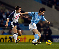 Photo: Jed Wee.<br /> Manchester City v Tottenham Hotspur. The Barclays Premiership. 04/01/2006.<br /> <br /> Manchester City's Sun Jihai (R) tries to shield the ball from Tottenham's Michael Brown.
