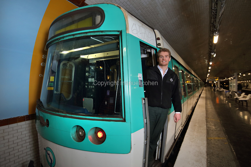 Martial, driver of a Line 13 RATP metro train, in the driver's cab of his train at Carrefour Pleyel metro station, Paris, France. Photographed 14th February 2019 by Manuel Cohen