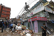 KATHMANDU, NEPAL - APRIL 29: (CHINA OUT) <br /> <br /> Rescue Operations Continue Following Devastating Nepal Earthquake<br /> <br /> Refugees surround at the collapsed buildings during the rescue team searching for lives on April 29, 2015 in Kathmandu, Nepal. A major 7.8 earthquake hit Kathmandu mid-day on Saturday, and was followed by multiple aftershocks that triggered avalanches on Mt. Everest that buried mountain climbers in their base camps. Many houses, buildings and temples in the capital were destroyed during the earthquake, leaving thousands dead or trapped under the debris as emergency rescue workers attempt to clear debris and find survivors. Regular aftershocks have hampered recovery missions as locals, officials and aid workers attempt to recover bodies from the rubble.<br /> ©Exclusivepix Media