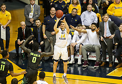 Jan 9, 2018; Morgantown, WV, USA; West Virginia Mountaineers guard Chase Harler (14) shoots a three pointer from the corner during the second half against the Baylor Bears at WVU Coliseum. Mandatory Credit: Ben Queen-USA TODAY Sports