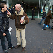 Nederland Rotterdam 15 maart 2008 20080315.straatevangelie op de lijnbaan in centrum Rotterdam. Moslim en christelijke evangelist in verhitte discussie over beide geloofsovertuigingen..Foto David Rozing