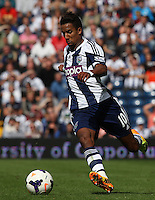 West Bromwich Albion's Scott Sinclair in action <br />  (Photo by Kieran Galvin/CameraSport) <br /> <br /> Football - Barclays Premiership - West Bromwich Albion v Swansea City - Sunday 1st September 2013 - The Hawthorns - West Midlands<br /> <br /> © CameraSport - 43 Linden Ave. Countesthorpe. Leicester. England. LE8 5PG - Tel: +44 (0) 116 277 4147 - admin@camerasport.com - www.camerasport.com