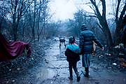 Sister Anna and a little girl walking the muddy way to the new growing shanty village close to Lunik IX. Some 95% of former inhabitants of the demolished houses in Lunik IX had no renting contract and with that no right for a compensatory flat. A few hundred meters beside Lunik IX grows a new shanty village with those families, they do not know where else to go.