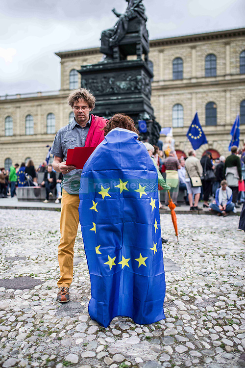 """June 4, 2017 - MüNchen, Bayern, Germany - Pro-EU demonstrators with the Frankfurt-based Pulse of Europe #pulseofeurope demonstrated in Munich the day after coordinated, suspected terror attacks that took place in London, England the night before.  There was little spoken of the London terror attacks, outside of a few sentences by John Friedmann, grounder of the Munich chapter after which the music and dancing program resumed.  Post-Brexit Britain has been a target of negative commentary by the Pulse of Europe movement..The Pulse of Europe movement was created to unify Europe and raise the voice of pro-EU supporters in the face of riding populism and right-radicalism.  Despite this, Pulse of Europe has explicitly welcomed Pegida members and right-radicals, as well as being criticized for what appears to be """"left-populism"""" that attempts to generate European unity through the channeling and normalization of the hatred of Russia, Turkey, post-Brexit Britain, and the United States.  Further criticisms blast the large amount of program materials being based on the United States and Trump and lack of concrete discussion based on Europe. (Credit Image: © Sachelle Babbar via ZUMA Wire)"""