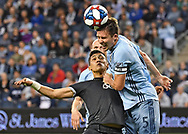 Matt Besler #5 of Sporting Kansas City heads the ball against Fredy Montero #12 of Vancouver Whitecaps FC during the first half on May 18, 2019 at Children's Mercy Park in Kansas City, Kansas.