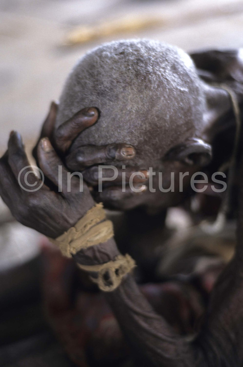 South Sudan. Famine. Rumbek. Old woman  left behind when everyone fled the town during fighting.