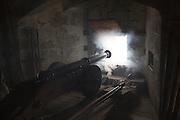 Cannon firing battle scene inside Pendennis castle, Falmouth, Cornwall, England, UK