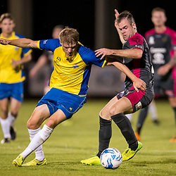 ADELAIDE, AUSTRALIA - SEPTEMBER 30: Michael Lee of Strikers and Reuben Way of Heidelberg during the Playstation 4 NPL National Grand Final match between Brisbane Strikers and Heidelberg United on September 30, 2017 in Brisbane, Australia. (Photo by Football Queensland / Patrick Kearney)