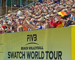 10-07-2011 VOLLEYBAL: FIVB WORLD TOUR BEACHVOLLEYBAL: GSTAAD<br /> Publiek support met Duitse vlag<br /> ©2011-www.FotoHoogendoorn.nl / Peter Schalk