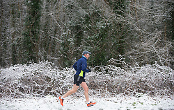 © Licensed to London News Pictures 24/01/2021.        Sevenoaks, UK. A man enjoying a break from Coronavirus lockdown with some fitness running in the snow at Badgers Mount near Sevenoaks in Kent as the cold weather continues across the UK. Photo credit:Grant Falvey/LNP