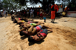 April 13, 2018 - Bhubaneswar, Odisha, India - Villagers and devotees roll n the hot sand on their village road as take penance when they are on way to their village goddess temple at Medhasal village outskirts of the eastern Indian state Odisha;s capital city Bhubaneswar on 14 April 2018, to mark their annual festival of Punishment 'Danda'. Eevery year on the beginning days of the local new year for the good wellness of their family and also universe. (Credit Image: © Str/NurPhoto via ZUMA Press)
