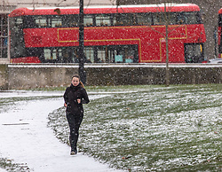 © Licensed to London News Pictures. 09/02/2021. London, UK. A runner exercises in a snowy Hyde Park Corner, London this morning as Storm Darcy hits the South East with yet more snow and freezing temperatures today. The Met Office have issue numerous weather warnings for heavy snow and ice with disruption to travel, power cuts and possible stranded vehicles as the bad weather continues throughout the country.  Photo credit: Alex Lentati/LNP