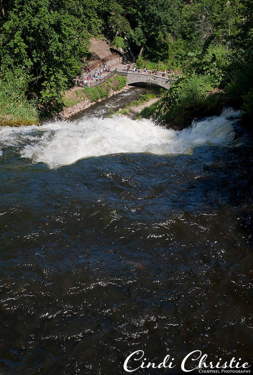 Minnehaha Falls flows in Minneapolis, MN, as visitors watch from a variety of perspectives on Monday, July 25, 2011. (© 2011 Cindi Christie/Cyanpixel Photography)