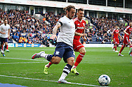 Stevie May of Preston North End clears the ball under pressure from Anthony Pilkington of Cardiff City. Skybet football league championship match, Preston North End v Cardiff City at the Deepdale stadium in Preston, Lancashire on Saturday 17th October 2105.<br /> pic by Chris Stading, Andrew Orchard sports photography.