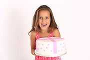 Happy and excited young girl with birthday cake