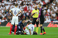 Ryan Bertrand of England being seen by the medical staff for an injury. FIFA World cup qualifying match, european group F, England v Malta at Wembley Stadium in London on Saturday 8th October 2016.<br /> pic by John Patrick Fletcher, Andrew Orchard sports photography.