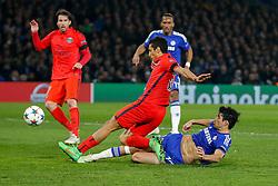 Diego Costa of Chelsea slides in to shoot as Marquinhos of Paris Saint-Germain challenges - Photo mandatory by-line: Rogan Thomson/JMP - 07966 386802 - 11/03/2015 - SPORT - FOOTBALL - London, England - Stamford Bridge - Chelsea v Paris Saint-Germain - UEFA Champions League Round of 16 Second Leg.