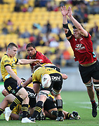 Crusaders Scott Barrett charges down a kick from Hurricanes Luke Campbell. Super Rugby Aotearoa. Hurricanes v Crusaders, Sky Stadium, Wellington. Sunday 11th April 2021. Copyright photo: Grant Down / www.photosport.nz