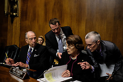 September 27, 2018 - Washington, District of Columbia, U.S. -  Chairman of the Senate Judiciary Committee CHARLES GRASSLEY, left, and ranking member DIANNE FEINSTEIN discuss with aids. The Senate Judiciary Committee holds a hearing for Dr. Christine Blasey Ford to testify about sexual assault allegations against Supreme Court nominee Judge Brett M. Kavanaugh at the Dirksen Senate Office Building on Capitol Hill. (Credit Image: © Gabriella Demczuk/Pool via ZUMA Wire)