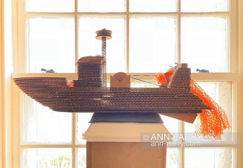 "Manhasset, New York, U.S. April 8, 2018. ""Trash Trawler"" cardboard and mixed media sculpture by artist MARC ISAACS is winner of Going Green Prize, seen at Reception for The Art Guild exhibition held at Elderfields Preserve."