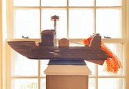 """Manhasset, New York, U.S. April 8, 2018. """"Trash Trawler"""" cardboard and mixed media sculpture by artist MARC ISAACS is winner of Going Green Prize, seen at Reception for The Art Guild exhibition held at Elderfields Preserve."""