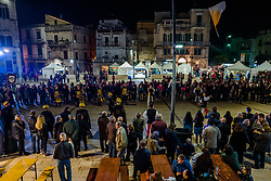 November 10, 2018 - Ruvo Di Puglia, Italy - People take part In Ruvo di Puglia, Italy, on 10 November 2018 at the 14th Edition of the Cardoncello Fungus Festival from 10-11 November 2018. Two days immersed in the nature with guided and thematic itineraries in the Alta Murgia Park and walks in the characteristic scenery of the historical center attending the traveling shows of folk groups and street artists, with the possibility to buy traditional products for sale in the stands in addition to the more cultural aspect, visit the most characteristic places of the historical center and the mushroom exhibition. (Credit Image: © Davide Pischettola/NurPhoto via ZUMA Press)