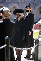 The Duchess of Cornwall and the Duchess of Cambridge at St George's Chapel, Windsor Castle, Berkshire, before the funeral of the Duke of Edinburgh. Picture date: Saturday April 17, 2021.