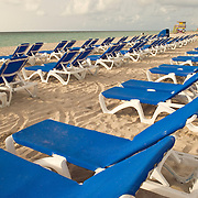 Lounge Chairs lined up in the morning at Miami Beach, Florida