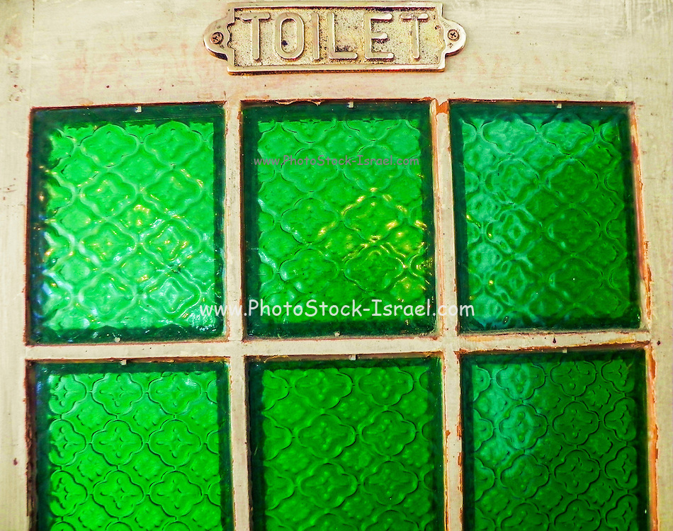 old style, retro toilet door with green glass