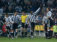 Photo. Glyn Thomas, Digitalsport<br /> Newcastle United v Vålerenga IF.<br /> UEFA Cup Third Round Second Leg.<br /> St James' Park, Newcastle. 03/03/2004.<br /> Newcastle's Shola Ameobi (arm raised) celebrates restoring his side's lead early in the second half.