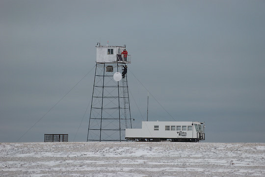 BJ Kirschhoffer and John Gunter climb the tower at Cape Churchill to trouble shoot radio transmission problems.