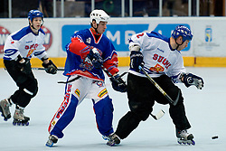 Aki Tuominen of Finland and Saso Rajsar, 22, of Slovenia at Game 1 of IIHF In-Line Hockey World Championships Top Division Group match between National teams of Finland and Slovenia on June 28, 2010, in Karlstad, Sweden. (Photo by Matic Klansek Velej / Sportida)