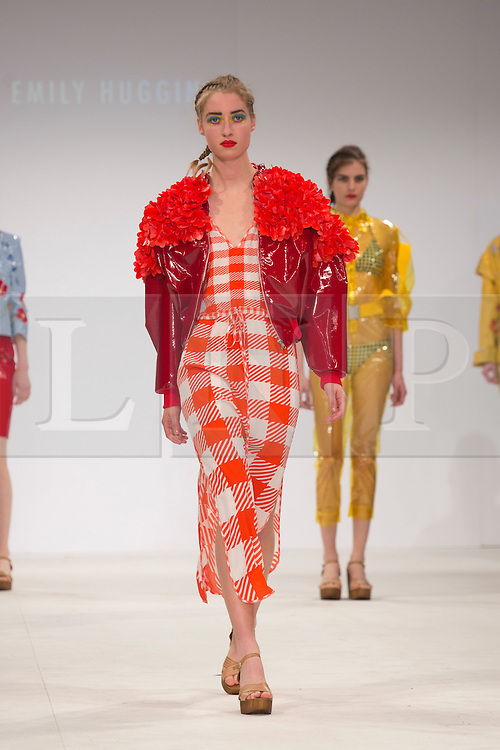 © Licensed to London News Pictures. 30/05/2015. London, UK. A model walks the runway during the Birmingham City University fashion show at Graduate Fashion Week 2015 wearing the collection of graduate student Emily Huggins. Graduate Fashion Week takes place from 30 May to 2 June 2015 at the Old Truman Brewery, Brick Lane. Photo credit : Bettina Strenske/LNP