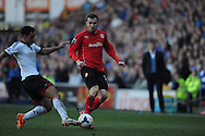 Fulham's Giorgos Karagounis challenges Cardiff City's Jordon Mutch (r) during the Barclays Premier league, Cardiff city v Fulham at the Cardiff city Stadium in Cardiff , South Wales on Sat 8th March 2014. pic by Jeff Thomas/Andrew Orchard sports photography