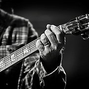 Black and white photograph of Neil Young performing at Miller Park for Farm Aid 2010 in Milwaukee, WI.