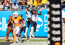 Sep 1, 2018; Charlotte, NC, USA; West Virginia Mountaineers wide receiver T.J. Simmons (1) celebrates with West Virginia Mountaineers tight end Jovani Haskins (84) after scoring a touchdown during the first quarter against the Tennessee Volunteers at Bank of America Stadium. Mandatory Credit: Ben Queen-USA TODAY Sports
