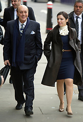 © Licensed to London News Pictures. 23/01/2012. London, UK. Cypriot businessman Asil Nadir accompanied by his wife, Nur arriving at the Old Bailey where he faces charges over an alleged £34m fraud at his firm Polly Peck. Nadir, who fled to Cyprus in 1993 after the charges were first brought by the SFO, was ordered to return to the UK at a High Court hearing. Photo credit: Simon Jacobs/LNP