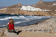 Greece, Cyclades,Naxos island: A girl looks at the sea